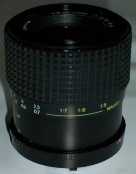TOKINA 35-70mm f/3.5-4.8 ULTRA ZOOM LENS FOR OLYMPUS OM SLR CAM